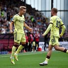 Arsenal's Martin Odegaard (left) celebrates scoring their side's first goal of the game during the P