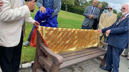"""The unveiling was attended by Cllr Roy Emmett (right), who said it was """"unique"""" to have a bench dedicated to living people."""