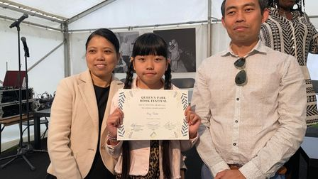 Under 12s winner May Thein with her proud parents