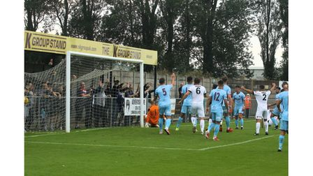 Weston AFC's Laird scores the opener against Taunton Town in the FA Cup.