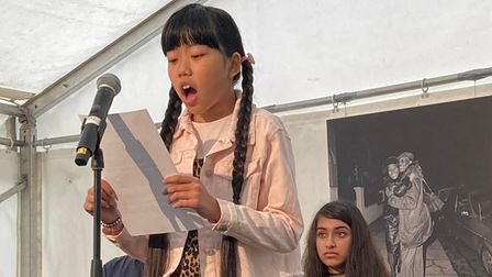 May Thein reading her winning entry