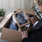 Woman is packing things of her dead husband
