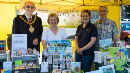 Four people, including the Mayor of Saffron Walden, at a Gardening for Kids stall