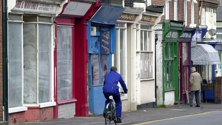(1of1) A part of Bells Road, Gorleston, showing disused shops, with currently trading shops (to the