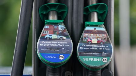 An E10 petrol pump by a Supreme petrol pump at a Petrol Station in Kettering. A cleaner form of petr