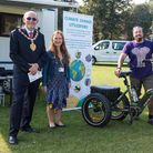 An electric bike at the Eco Market in Saffron Walden - accompanied by Cllrs Porch and Pepper, and two stallholders