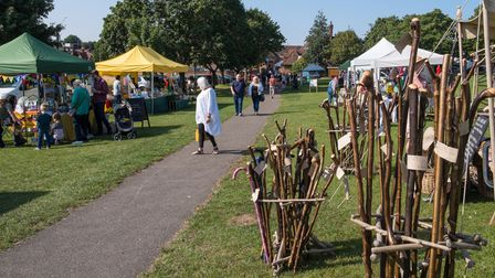 Wicker chairs in front of a row of marquees on The Common, Saffron Walden for the eco market