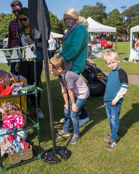 Two children browse a stall at the Saffron Walden Eco Market