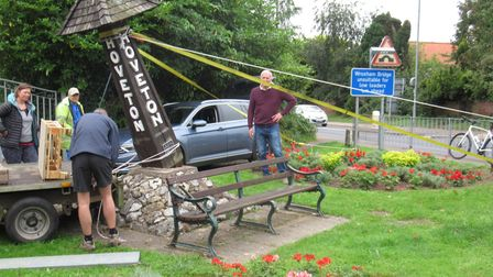 The village sign in Hoveton being removed after it had begun to lean due to rotting wood.