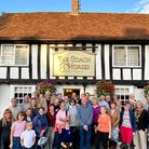 A large group of people in front of the Coach and Horses pub in Newport, Essex