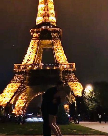 Liam Goddard and Kimberley Page in front of the Eiffel Tower