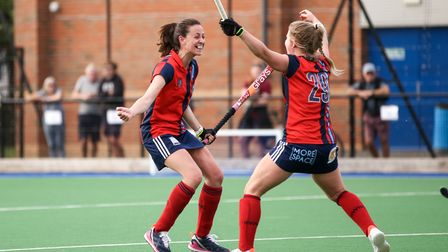 Emily Douglas and Esme Burge of Hampstead and Westminster celebrate a goal against Wimbledon