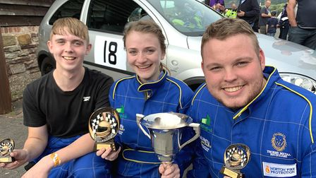 Lizzy Dudley with runner-up Alfie Nelson-Westlake (left) and James Gwilliam after the Shelsley Walsh Hill Climb