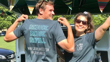 Two people - Dan and Gabs - under a gazebo at Saffron Walden's Eco Market. Dan's shirt reads: Reduce, Reuse, Recycle