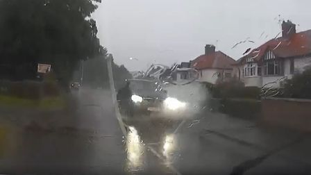 The driver didn't seem to notice the schoolgirl walking right beside the puddle, and soaked her through