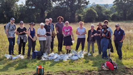 Cllr Sam Collins andKeith Fitzpatrick-Matthews with some volunteers and a small sample of the finds at the Hitchin fieldwalk