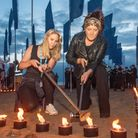 NHS staff lighting candles at the In Memoriam art installation on Weston Beach.
