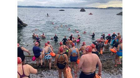 Group of swimmers entering sea