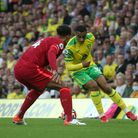 Ben Gibson of Norwich and Adam Idah of Norwich in action during the Premier League match at Carrow R