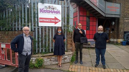 Kidzmania owners and supports gather outside the Hackney soft play centre.