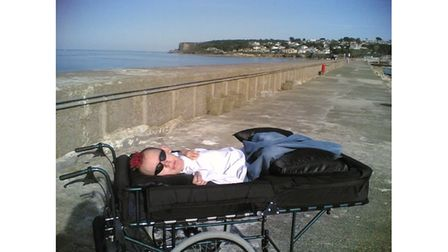 Disabled man on seafront