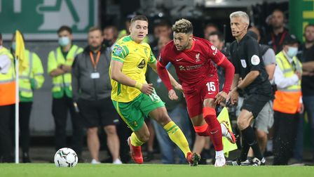 Christos Tzolis of Norwich and Alex Oxlade-Chamberlain of Liverpool in action during the Carabao Cup