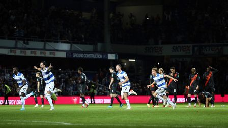 Queens Park Rangers players celebrate winning the penalty shoot out during the Carabao Cup third rou