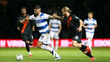 Queens Park Rangers' Charlie Austin holds off Everton's Tom Davies during the Carabao Cup third roun