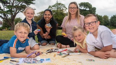 Tania Bodalia (centre left) from Weston Super Rocks with young rock painters at the Love the Outdoor