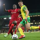 Ibrahima Konate of Liverpool and Christos Tzolis of Norwich in action during the Carabao Cup match a