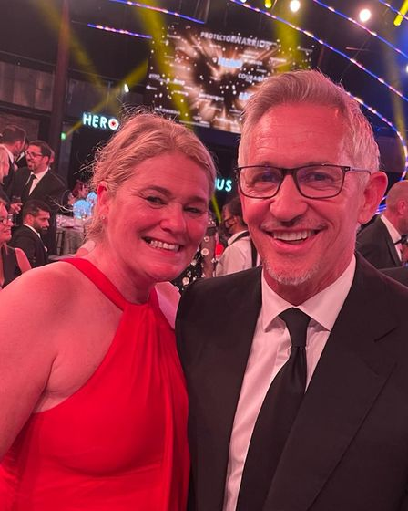 Annie Aris in a red dress next to Gary Lineker at The Sun Who Cares Wins awards in Camden