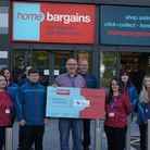 A cheque was presented to Weston Hospicecare from Home Bargains.