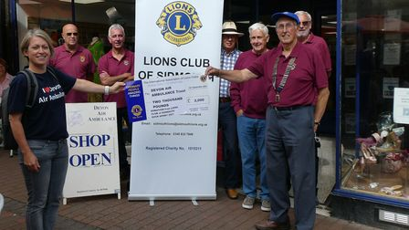 The 'big cheque' was received with grateful thanks by Sarah Shaw of DAAT, from Sidmouth Lions Club's