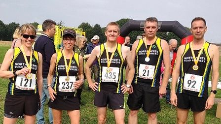 North Herts Road Runners show off their medals a the finish of the Stevenage 10k.