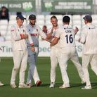 Jamie Porter of Essex celebrates with his team mates after taking the wicket of Emilio Gay during Es