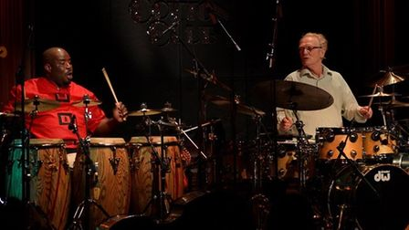 Abass Dodoo and Ginger Baker drumming together in the Cotton Club in Japan.