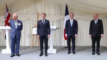 (left to right) The Prince of Wales, French president Emmanuel Macron, Foreign Secretary Dominic Raa