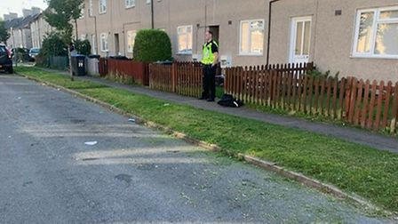 A police officer outside the address in Stockbreach Road, Hatfield, where the dog attack occurred.