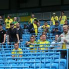 The traveling Norwich fans in the new rail seating before the Premier League match at the Etihad Sta