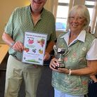 Andrew Marshall receives the trophy for best council allotment from councillor Eric Bowman