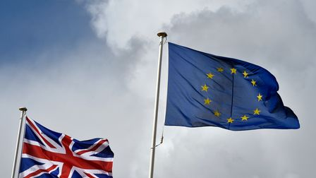 File photo dated 27/11/2015 of the Union flag fluttering next to the EU flag, as polling suggests th