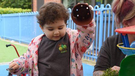One of the children from the brand new Treetops Nursery, at Hethersett VC Primary School, playing in