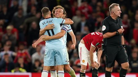 West Ham United's Nikola Vlasic (left) and Mark Noble celebrate the win after the Carabao Cup third