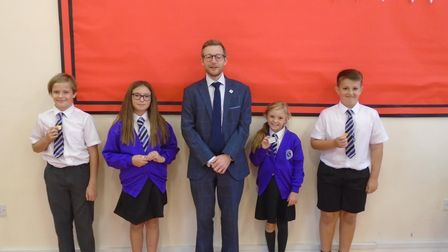MP Duncan Baker with some of the Stalham Infant School Year 6 pupils who have taken on new roles.