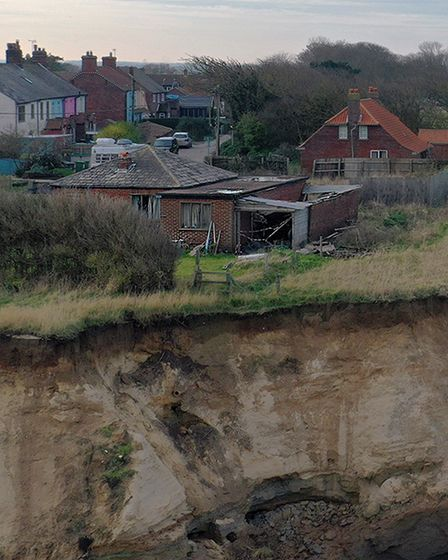 A home awaiting demolition at Happisburgh, one of the effects of coastal erosion.