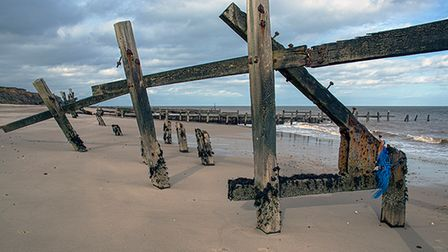 Crumbling sea defences at Happisburgh, once put in place to slow the rate of coastal erosion.