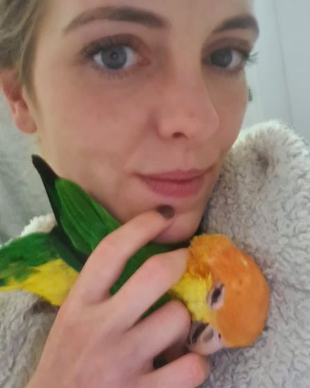 Daisy Jane from Norwich with one of her parrots.
