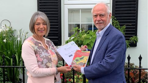 Stefan Buczacki presents Caroline Caine with £250 worth of Webbs garden vouchers, along with a signed copy of his book