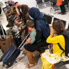 Refugees from Afghanistan arriving on a evacuation flight at Heathrow Airport.