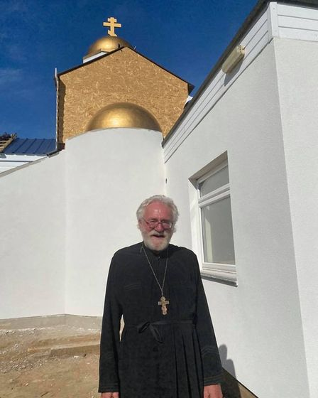 Fr Steven Weston outside St Fursey's Church on Yarmouth Road in Stalham.